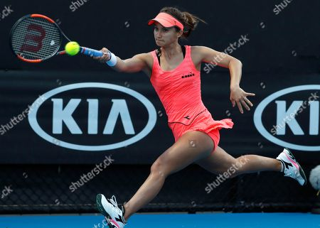 United States' Lauren Davis reaches for a return to Slovakia's Jana Cepelova during their first round match at the Australian Open tennis championships in Melbourne, Australia