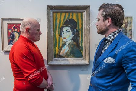 Stock Picture of Amy Winehouse by Dan Llywelyn Hall (pictured in blue)  - The 30th London Art Fair 2018 at the Business Design Centre, Islington.