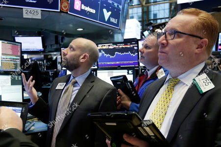 Meric Greenbaum, Michael COnlon, Daniel Ryan. Specialist Meric Greenbaum, left, works with traders Michael Conlon, center, and Daniel Ryan on the floor of the New York Stock Exchange, . The Dow Jones industrial average traded above 26,000 for the first time