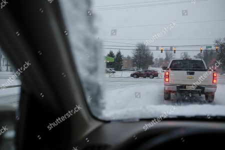 Snow and ice slowed traffic to a crawl along US Highway 70s at Sawyer Brown Road in Nashville, Tennessee, USA, 16 January 2018. An ice storm with cold temperatures gripped much of the Deep South forcing businesses and schools to close in much of the area.