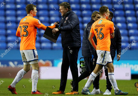 Stock Photo of Reading goalkeeping coach Dave Beasant congratulates Jon Dadi Bodvarsson at full time.