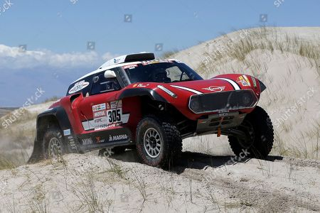 Driver Mikko Hirvonen, of Finland, and co-driver Andreas Schulz, of Germany, race their Mini during the 10th stage of the 2018 Dakar Rally between Salta and Belen, Argentina
