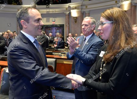 Matt Bevin, Alison Lundergan Grimes. Kentucky Gov. Matt Bevin, left, shakes hands with Kentucky Secretary of State Alison Lundergan Grimes before his State of The Commonwealth address at the Kentucky State Capitol, in Frankfort, Ky