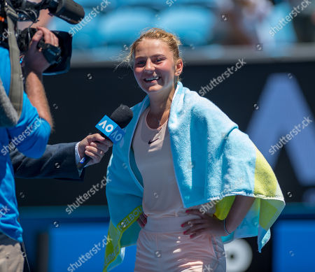 Fifteen year old Marta Kostyuk (UKR) smiles at the on court post match interview after her second round match with Olivia Rogowska (AUS).  Australian Open Tennis Championships, Melbourne Park, Melbourne, Australia.17th January 2018.