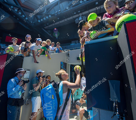 Fifteen year old Marta Kostyuk (UKR) autographs a tennis ball for a fan after her second round match with Olivia Rogowska (AUS).  Australian Open Tennis Championships, Melbourne Park, Melbourne, Australia.17th January 2018.