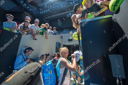 Stock Photo of Fifteen year old Marta Kostyuk (UKR) autographs a baseball cap for a fan after her second round match with Olivia Rogowska (AUS).  Australian Open Tennis Championships, Melbourne Park, Melbourne, Australia.17th January 2018.