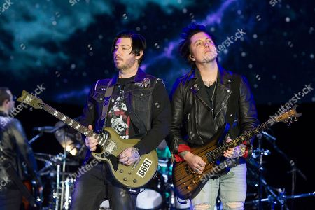 """Zacky Vengeance, Synyster Gates. Zacky Vengeance, left, and Synyster Gates of the band Avenged Sevenfold perform in concert during their """"The Stage World Tour"""" at the Santander Arena, in Reading, Pa"""