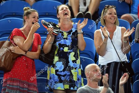Spectators reacts after catching a shoe thrown by Alexandr Dolgopolov of Ukraine during his second round match against Matthew Ebden of Australia at the Australian Open Grand Slam tennis tournament in Melbourne, Australia, 17 January 2018.