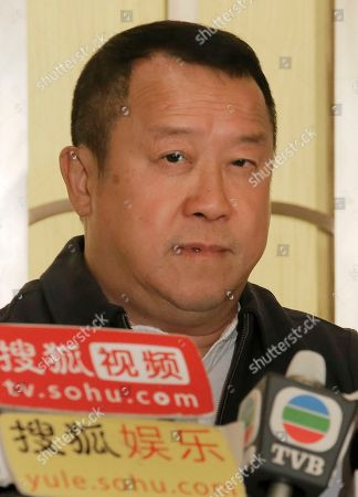 Hong Kong actor Eric Tsang pauses during a press conference in Hong Kong, . Tsang vehemently denies rumors of allegedly sexual harassment made against him. Tsang said that all accusations are fabricated