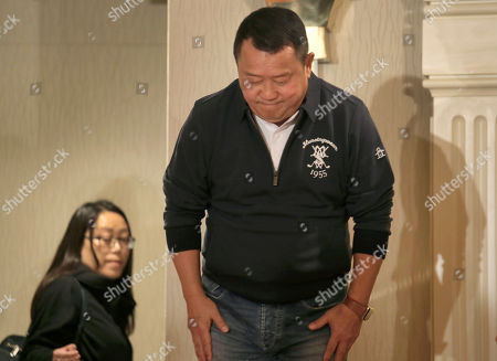 Hong Kong actor Eric Tsang bows at the end of a press conference in Hong Kong, . Tsang vehemently denies rumors of allegedly sexual harassment made against him. Tsang said that all accusations are fabricated