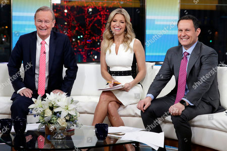 "Steve Doocy, Ainsley Earhardt, Brian Kilmeade. Co-hosts Steve Doocy, left, Ainsley Earhardt, center, and Brian Kilmeade, co-hosts of the ""Fox & friends"" television program, are photographed in New York"