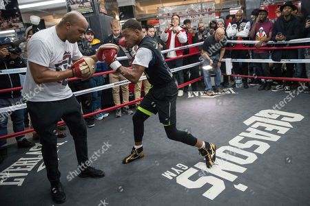 Errol Spence Jr. throws a punch while sparring with a trainer during a workout at Gleason's Gym, in the Brooklyn borough of New York. Spence is slated to defend his IBF welterweight title against Lamont Peterson on Saturday in Brooklyn