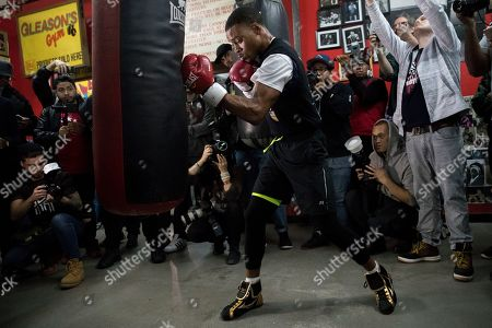 Errol Spence Jr. hits a punching bag during a workout at Gleason's Gym, in the Brooklyn borough of New York. Spence is slated to defend his IBF welterweight title against Lamont Peterson on Saturday in Brooklyn