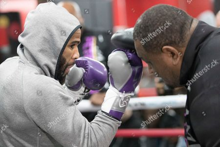 Lamont Peterson throws a punch while sparring with a trainer during a workout at Gleason's Gym, in the Brooklyn borough of New York. Peterson faces Errol Spence Jr. on Saturday in Brooklyn, for Spence's IBF welterweight title
