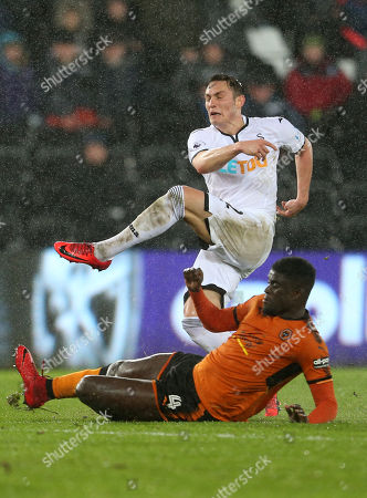 Connor Roberts of Swansea City is tackled by Alfred N'Diaye of Wolverhampton Wanderers.