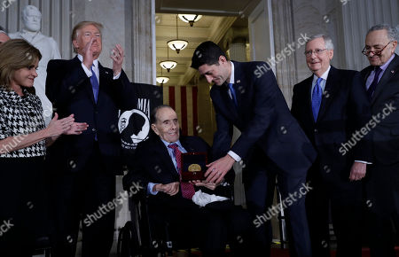 House Speaker Paul Ryan of Wis., presents the Congressional Gold Medal to former Sen. Bob Dole on Capitol Hill, in Washington. Watching from left are Rep. Lynn Jenkins, R-Kan., President Donald Trump, Senate Majority Leader Mitch McConnell of Ky., and Senate Minority Leader Chuck Schumer of N.Y