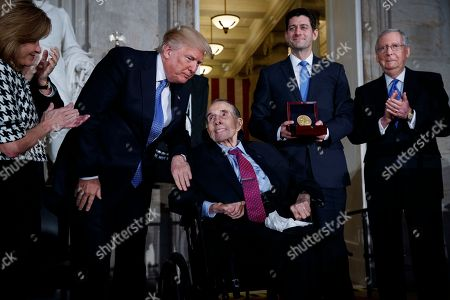 Donald Trump, Lynn Jenkins, Bob Dole, Paul Ryan, Mitch McConnell. President Donald Trump congratulates former Sen. Bob Dole during a ceremony to award him the Congressional Gold Medal on Capitol Hill, in Washington. From left, Rep. Lynn Jenkins, R-Kan., Trump, Dole, Speaker of the House Rep. Paul Ryan, R-Wis., and Senate Majority Leader Sen. Mitch McConnell, R-Ky