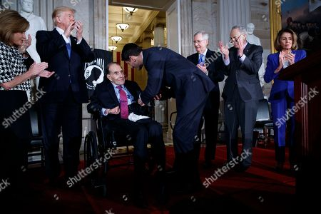 Donald Trump, Lynn Jenkins, Bob Dole, Paul Ryan, Mitch McConnell, Chuck Schumer, Nancy Pelosi. President Donald Trump watches as Speaker of the House Rep. Paul Ryan, R-Wis., awards former Sen. Bob Dole the Congressional Gold Medal during a ceremony on Capitol Hill, in Washington. From left, Rep. Lynn Jenkins, R-Kan., Trump, Dole, Ryan, Senate Majority Leader Sen. Mitch McConnell, R-Ky., Senate Minority Leader Sen. Chuck Schumer, D-N.Y., and House Minority Leader Rep. Nancy Pelosi, D-Calif