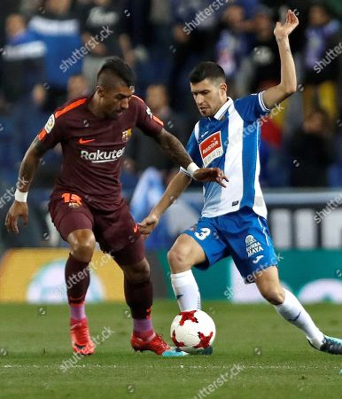 Barcelona's Jose Paulo Bezerra 'Paulinho' (L) in action with Espanyol´s Aaron Martin (R) during the first leg of the Spanish King's Cup quarter final match between RCD Espanyol and FC Barcelona in Cornella, Barcelona, Spain, 17 January 2018.