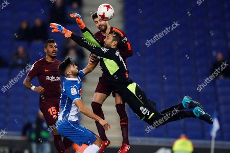 Stock Photo of Barcelona's players Jose Paulo Bezerra 'Paulinho' (L), Gerard Pique (R-back) and goalkeeper Diego Lopez (R-front) in action with Espanyol´s Mario Hermoso (2-L) during the first leg of the Spanish King's Cup quarter final match between RCD Espanyol and FC Barcelona in Cornella, Barcelona, Spain, 17 January 2018.