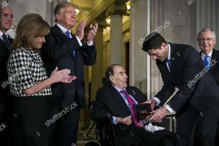 Former Senator Bob Dole (C) is presented with the congressional Gold Medal by US House Speaker Paul Ryan (3-R) at the U.S. Capitol, in Washington, D.C., USA, 17 January 2018, in the presence of (L-R) US Vice President Mike Pence, Congresswoman Lynn Jenkins, a Republican from Kansas, US President Donald J. Trump, and Senate Majority Leader Mitch McConnell, a Republican from Kentucky.