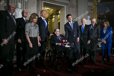 Former Senator Bob Dole (C) is presented with the congressional Gold Medal by US House Speaker Paul Ryan (4-R) at the U.S. Capitol, in Washington, D.C., USA, 17 January 2018, in the presence of (L-R) House Minority Whip Steny Hoyer, US Vice President Mike Pence, Congresswoman Lynn Jenkins, a Republican from Kansas, US President Donald J. Trump, Senate Majority Leader Mitch McConnell, a Republican from Kentucky, Senate Minority Leader Chuck Schumer, a Democrat from New York, and House Majority Leader Nancy Pelosi, a Democrat from California.