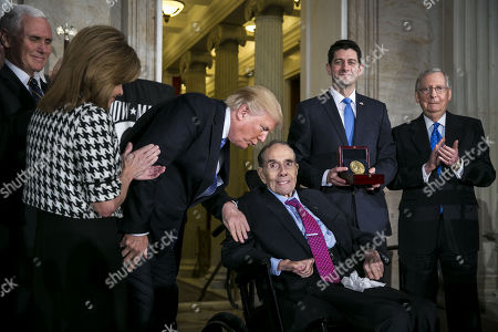 US President Donald Trump (3-L) greets former Senator Bob Dole (3-R) as he is presented with the congressional Gold Medal, by US House Speaker Paul Ryan (2-R) at the US Capitol, in Washington, D.C., USA, 17 January 2018, in the presence of (L-R) US Vice President Mike Pence, Congresswoman Lynn Jenkins, a Republican from Kansas and Senate Majority Leader Mitch McConnell, a Republican from Kentucky.