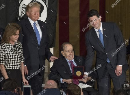 Speaker of the United States House Paul Ryan (Republican of Wisconsin) presents the Congressional Gold Medal to former US Senator Bob Dole (Republican of Kansas) in the Rotunda of the US Capitol. From left to right: US Representative Lynn Jenkins (Republican of Kansas), US President Donald Trump, Senator Dole, and Speaker Ryan.