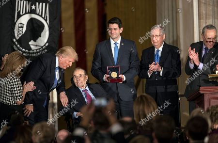 Bob Dole, Donald Trump, Lynn Jenkins, Paul Ryan, Mitch McConnell, Chuck Schumer. Former Senate Majority Leader Bob Dole smiles as he is joined by, from left, Rep. Lynn Jenkins, R-Kan., President Donald Trump, Speaker of the House Paul Ryan, R-Wis., Senate Majority Leader Mitch McConnell, R-Ky., and Senate Minority Leader Chuck Schumer, D-N.Y., as he is honored at the Capitol with a Congressional Gold Medal in Washington