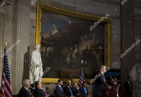 U.S. President Donald Trump speaks during a congressional Gold Medal ceremony for former Senator Bob Dole, in Washington D.C., U.S.,. From left: U.S. Vice President Mike Pence, former Senator Bob Dole, U.S. House Speaker Paul Ryan, a Republican from Wisconsin, Senate Majority Leader Mitch McConnell, a Republican from Kentucky, Senate Minority Leader Chuck Schumer, a Democrat from New York, and House Minority Leader Nancy Pelosi, a Democrat from California.