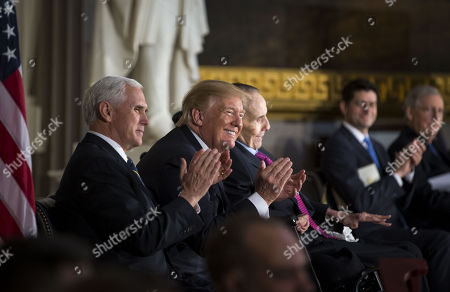 U.S. Vice President Mike Pence, U.S. President Donald Trump, and former Senator Bob Dole during a congressional Gold Medal ceremony for Dole, in Washington D.C., U.S.,.