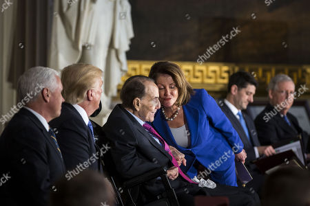 House Minority Leader Nancy Pelosi, a Democrat from California, greets former Senator Bob Dole, beside U.S. President Donald Trump and U.S. Vice President Mike Pence, during a congressional Gold Medal ceremony, at the U.S. Capitol, in Washington D.C., U.S.,.