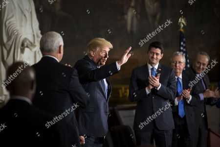 U.S. President Donald Trump waves during a congressional Gold Medal ceremony for former Senator Bob Dole, in Washington D.C., U.S.,. From left: U.S. Vice President Mike Pence, Trump, U.S. House Speaker Paul Ryan, a Republican from Wisconsin, Senate Majority Leader Mitch McConnell, a Republican from Kentucky, and Senate Minority Leader Chuck Schumer, a Democrat from New York.