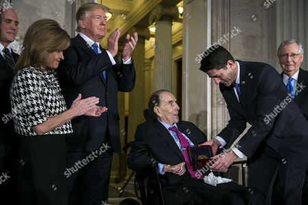 Former Senator Bob Dole is presented with the congressional Gold Medal, by U.S. House Speaker Paul Ryan, a Republican from Wisconsin, at the U.S. Capitol, in Washington D.C., U.S.,. From left: U.S. Vice President Mike Pence, Congresswoman Lynn Jenkins, a Republican from Kansas, U.S. President Donald Trump, Dole, Ryan, and Senate Majority Leader Mitch McConnell, a Republican from Kentucky.