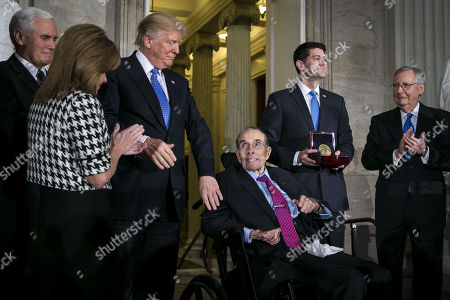 U.S. President Donald Trump greets former Senator Bob Dole as he is presented with the congressional Gold Medal, by U.S. House Speaker Paul Ryan, a Republican from Wisconsin, at the U.S. Capitol, in Washington D.C., U.S.,. From left: U.S. Vice President Mike Pence, Congresswoman Lynn Jenkins, a Republican from Kansas, Trump, Dole, Ryan, and Senate Majority Leader Mitch McConnell, a Republican from Kentucky.