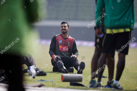 Bangladesh's Nasir Hossain stretches during a training session ahead of their match against Sri Lanka in the Tri-Nation one-day international cricket series in Dhaka, Bangladesh, . Bangladesh is scheduled to play against Sri Lanka on Jan. 19 in Dhaka