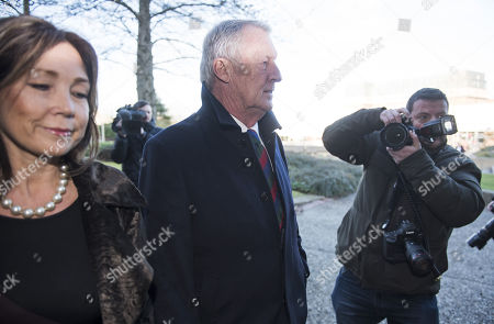 Television presenter Chris Tarrant arrives at Reading Magistrates Court with his partner Jane Bird where he faces drink driving charges.