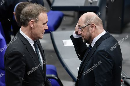 The vice president of the German Parliament of the Social Democratic Party (SPD), Thomas Oppermann (L), and the leader of the Social Democratic Party (SPD), Martin Schulz, talk prior to a session of the German parliament 'Bundestag' in Berlin, Germany, 18 January 2018.
