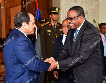"""Abdel-Fattah el-Sissi, Hailemariam Desalegn. In this photo provided by Egypt's state news agency, MENA, Egyptian President Abdel-Fattah el-Sissi, left, shakes hands with Ethiopian Prime Minister Hailemariam Desalegn, in Cairo, Egypt, . El-Sissi said Thursday he expressed his """"extreme concern"""" over the lack of progress in talks over the construction of a massive Nile dam in Ethiopia during a meeting with Desalegn. Egypt fears the dam, which is about 60 percent complete, will significantly reduce its vital share of the Nile's waters"""