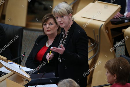 Scottish Parliament General Questions - Fiona Hyslop, Cabinet Secretary for Culture, Europe and External Affairs, listens to Shona Robison, Cabinet Secretary for Health, Wellbeing and Sport, answering a question during General Questions immediately before First Minister's Questions
