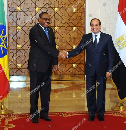 """Abdel-Fattah el-Sissi, Hailemariam Desalegn. In this photo provided by Egypt's state news agency, MENA, Egyptian President Abdel-Fattah el-Sissi, right, shakes hands with Ethiopian Prime Minister Hailemariam Desalegn, in Cairo, Egypt, . El-Sissi said Thursday he expressed his """"extreme concern"""" over the lack of progress in talks over the construction of a massive Nile dam in Ethiopia during a meeting with Desalegn. Egypt fears the dam, which is about 60 percent complete, will significantly reduce its vital share of the Nile's waters"""