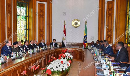 """Abdel-Fattah el-Sissi, Hailemariam Desalegn. In this photo provided by Egypt's state news agency, MENA, Egyptian President Abdel-Fattah el-Sissi, left, and his delegations meet with Ethiopian Prime Minister Hailemariam Desalegn, right, and his delegations in Cairo, Egypt, . El-Sissi said Thursday he expressed his """"extreme concern"""" over the lack of progress in talks over the construction of a massive Nile dam in Ethiopia during a meeting with Desalegn. Egypt fears the dam, which is about 60 percent complete, will significantly reduce its vital share of the Nile's waters"""