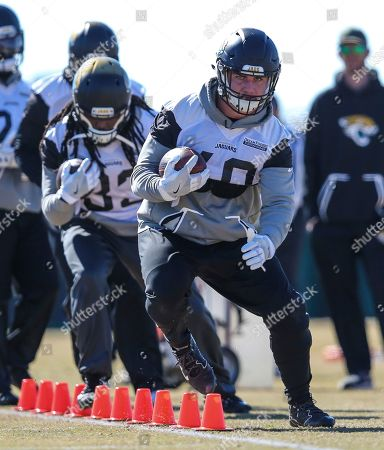 Jacksonville Jaguars fullback Tommy Bohanon (40), right, takes part in a drill during an NFL football practice in Jacksonville, Fla
