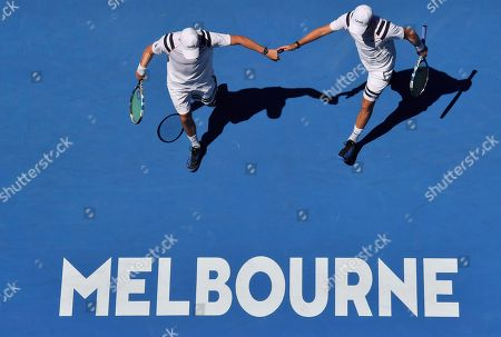 Bob Mike Bryan. United States' Bob, right, and Mike Bryan celebrates a point win in men's doubles second round match against Max Mirnyi of Belarus and Austria's Phillip Oswald at the Australian Open tennis championships in Melbourne, Australia