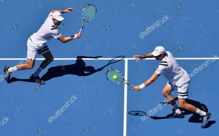 Bob Mike Bryan. United States' Bob, right, and Mike Bryan play in men's doubles second round match against Max Mirnyi of Belarus and Austria's Phillip Oswald at the Australian Open tennis championships in Melbourne, Australia
