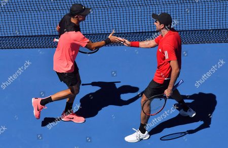 Max Mirnyi Phillip Oswald. Max Mirnyi, left, of Belarus and Austria's Phillip Oswald celebrates a point win over in men's doubles match against United States' Bob and Mike Bryan at the Australian Open tennis championships in Melbourne, Australia