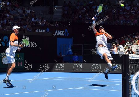 Bob Mike Bryan. United States' Bob, left, and Mike Bryan play in men's doubles match against Max Mirnyi of Belarus and Austria's Phillip Oswald at the Australian Open tennis championships in Melbourne, Australia