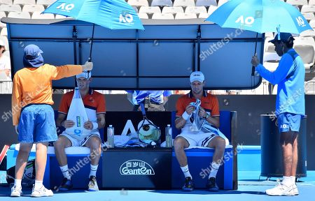 Bob Mike Bryan. United States' Bob, left, and Mike Bryan sit on char during a break in men's doubles match against Max Mirnyi of Belarus and Austria's Phillip Oswald at the Australian Open tennis championships in Melbourne, Australia