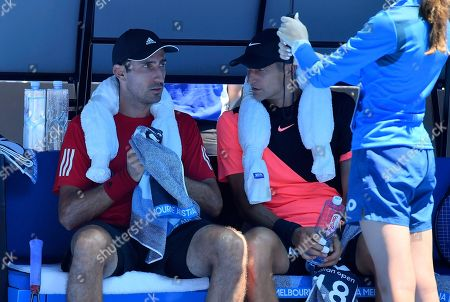 Max Mirnyi Phillip Oswald. Max Mirnyi, right, of Belarus and Austria's Phillip Oswald, left, talk during a change in ends in their men's doubles match against United States' Bob and Mike Bryan at the Australian Open tennis championships in Melbourne, Australia