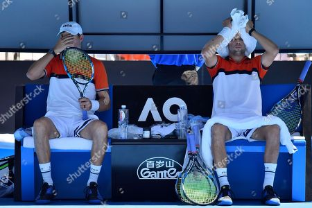 Bob Mike Bryan. United States' Bob, left, and Mike Bryan, right, cool down during a break in their men's doubles match against Max Mirnyi of Belarus and Austria's Phillip Oswald at the Australian Open tennis championships in Melbourne, Australia